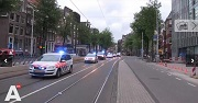 AT5 Politiemacht met loeiende sirenes